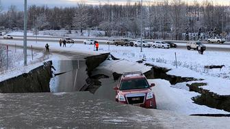 FILE - In this Friday, Nov. 30, 2018 file photo, a vehicle is trapped on a section of road that collapsed during an earthquake in Anchorage, Alaska. The collapsed roadway that became an iconic image of the destructive force of a magnitude 7.0 earthquake and its aftershocks was repaired just days after the quake. The off-ramp connecting Minnesota Drive and a road to Ted Stevens Anchorage International Airport reopened Tuesday, Dec. 4, 2018, with shoulder work finished Wednesday. (AP Photo/Dan Joling, File )