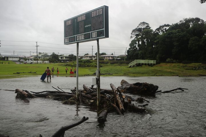 Floodwaters surround a baseball scoreboard during flooding from Tropical Storm Lane on the Big Island, in Hilo, Hawaii.