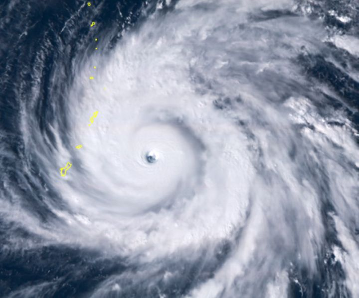 A satellite image shows Typhoon Yutu east of Guam, set to cross over the U.S. commonwealth of the Northern Mariana Islands wi