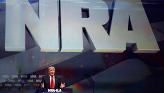 U.S. Republican presidential candidate Donald Trump attends the National Rifle Association's NRA-ILA Leadership Forum during their annual meeting in Louisville, Kentucky, U.S., May 20, 2016. REUTERS/Aaron P. Bernstein     TPX IMAGES OF THE DAY