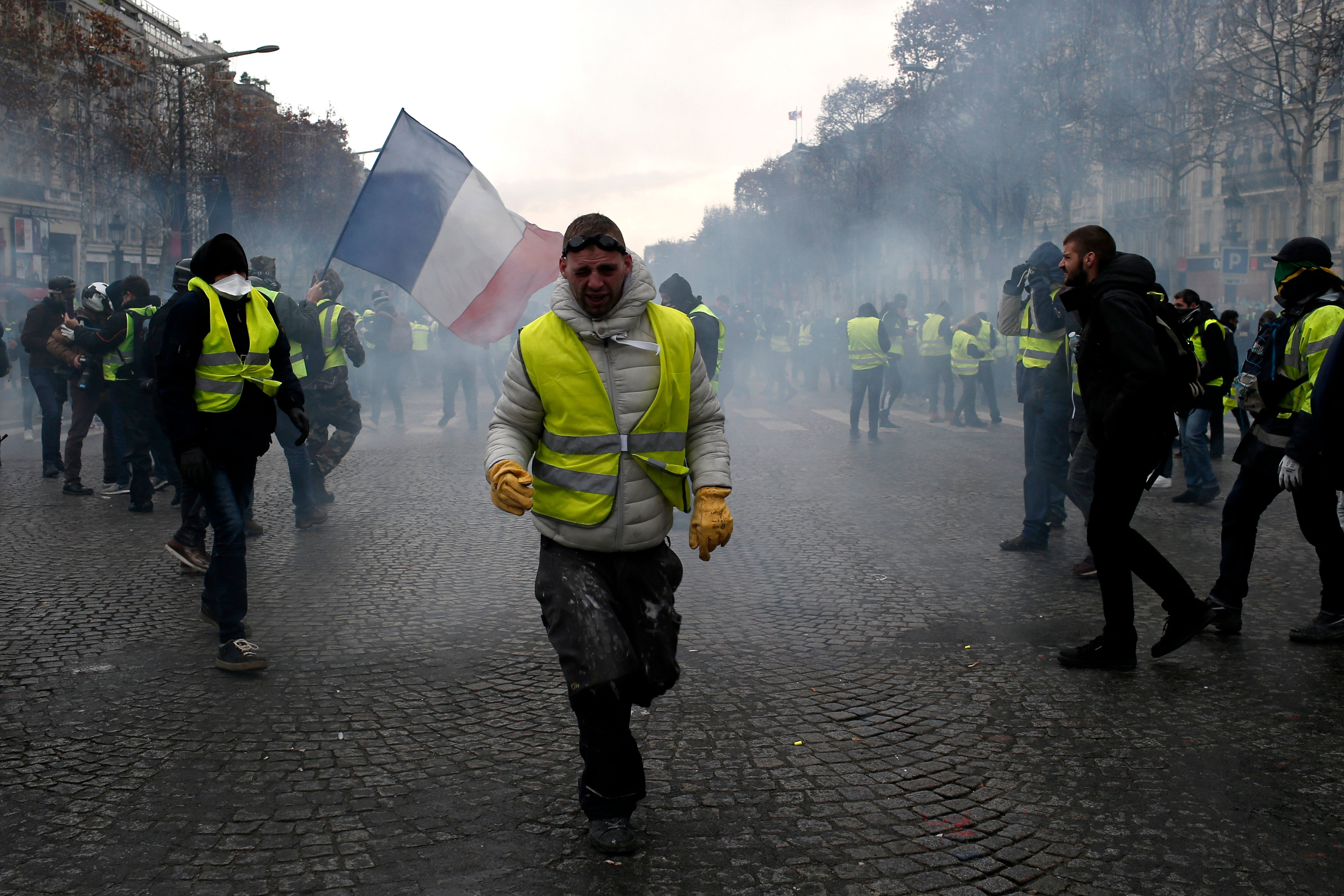 French Police Fire Tear Gas As Yellow-Vested Protesters Swarm Paris