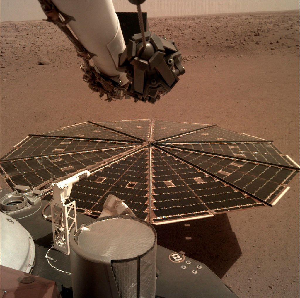 This Friday, Dec. 7, 2018 photo made available by NASA shows a view from the arm-mounted camera on the InSight Mars lander. The spacecraft arrived on the planet on Nov. 26. (NASA/JPL-Caltech via AP)