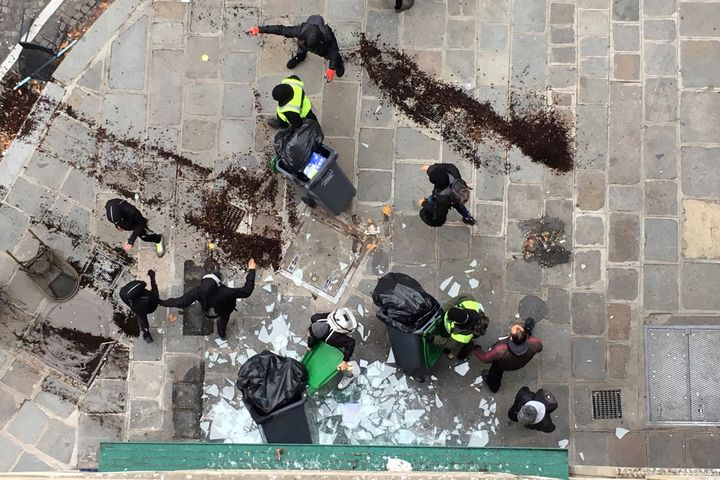 Demonstrators vandalise a branch of American coffee chain Starbucks in Paris, France.
