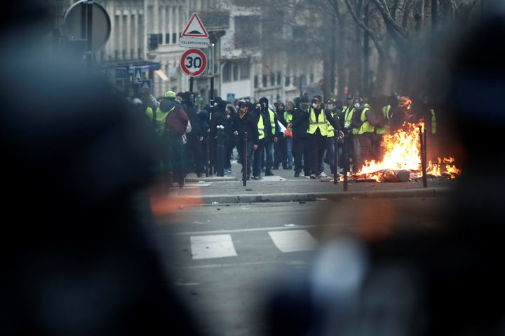Fires flashed during Saturday's riots in Paris.