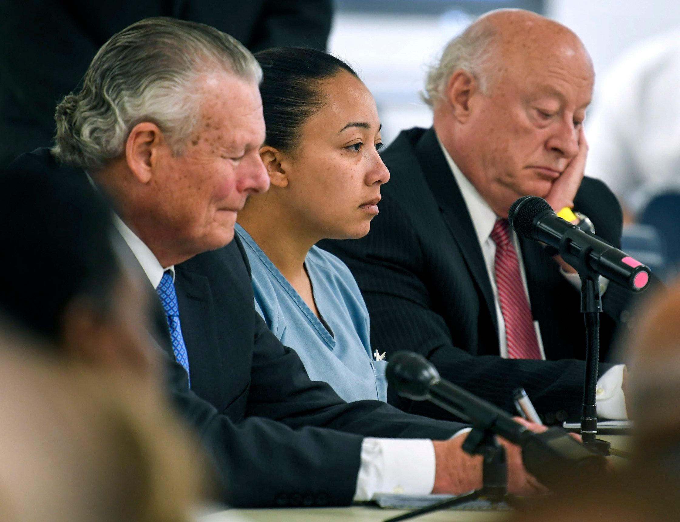 Cyntoia Brown sits between her council Charles Bone, left and Houston Gordon, right, as they listen to the parole boards split decision in her clemency hearing at the Tennessee Prison for Women in Nashville, Tenn., Wednesday, May 23, 2018. A six-member Tennessee Board of Parole is divided on whether to release Brown, who is serving a life sentence, for killing a man when she was a 16-year-old prostitute. (Lacy Atkins/The Tennessean via AP, Pool)