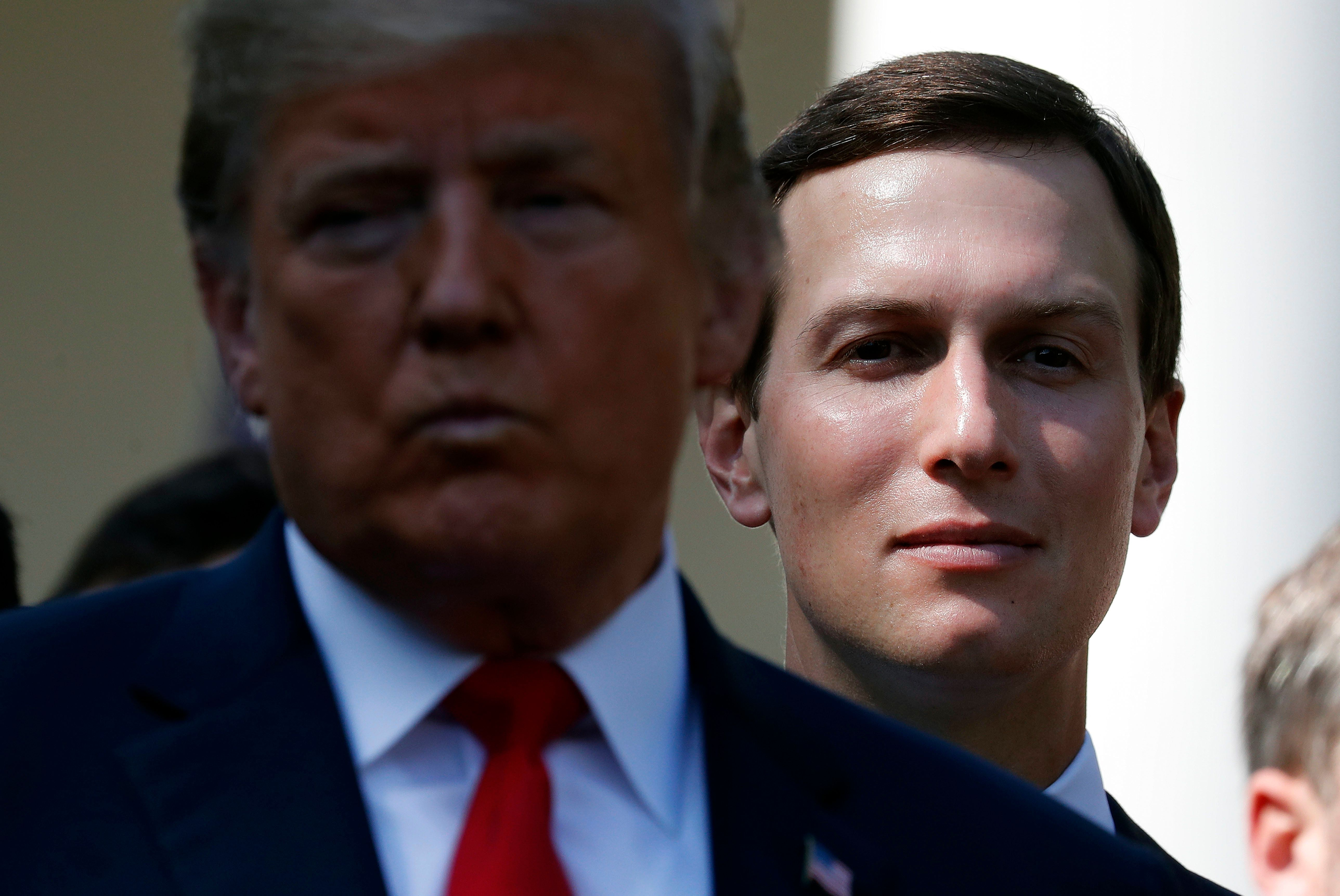 White House senior adviser Jared Kushner, right, stands behind President Donald Trump, left, during a news conference as he announces a revamped North American free trade deal, in the Rose Garden of the White House in Washington, Monday, Oct. 1, 2018. The new deal, reached just before a midnight deadline imposed by the U.S., will be called the United States-Mexico-Canada Agreement, or USMCA. It replaces the 24-year-old North American Free Trade Agreement, which President Donald Trump had called a job-killing disaster. (AP Photo/Pablo Martinez Monsivais)
