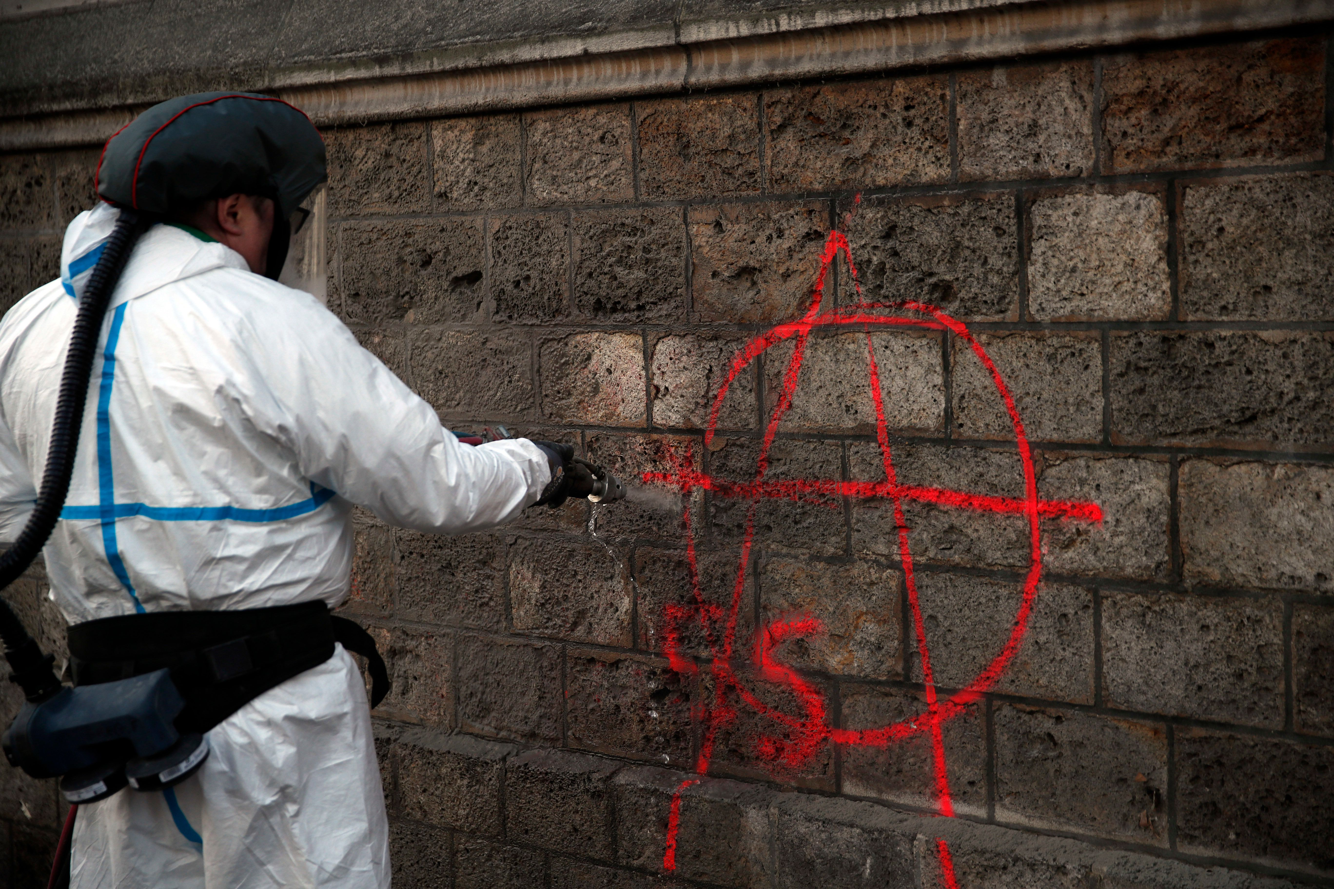 Paris Cleans Up In Aftermath Of Riot As Macron Prepares Address