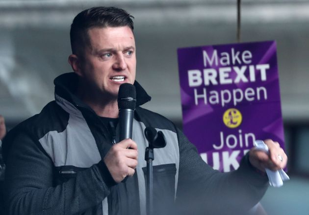Tommy Robinson addresses the rally after taking part in a