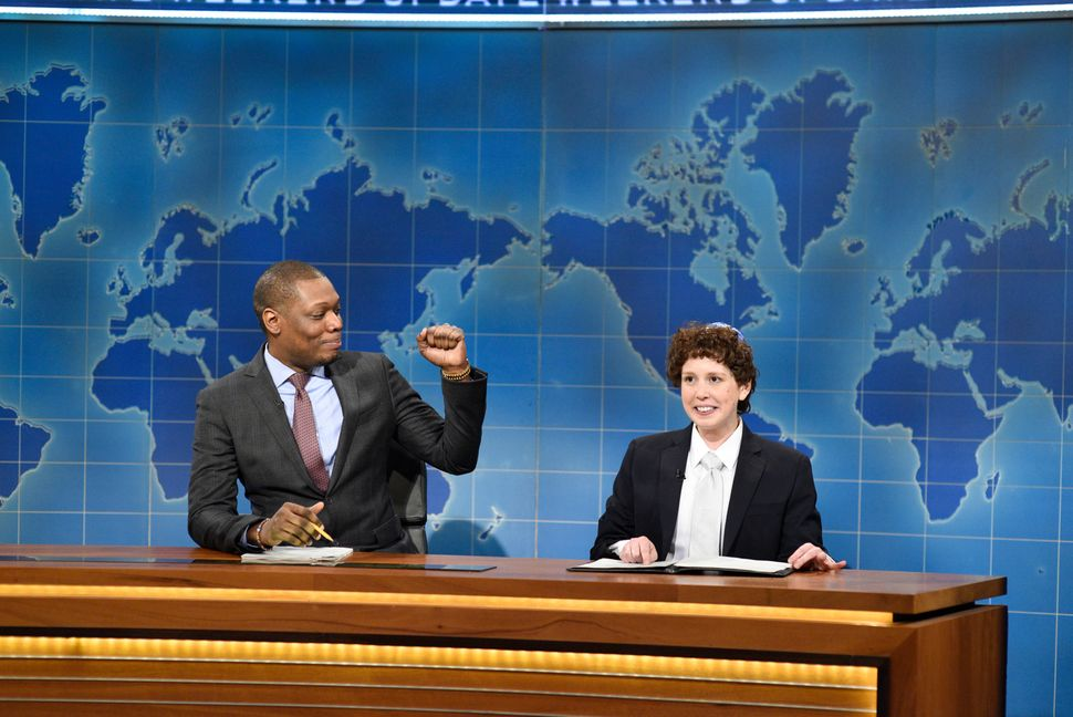 "Michael Che and Vanessa Bayer as 'Jacob the Bar Mitzvah Boy' during ""Weekend Update"" on ""SNL"" on April 15, 2017."