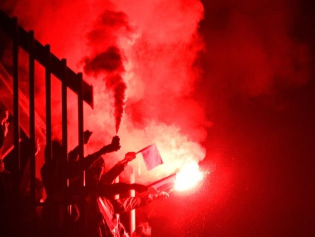 People light flares at an anti-far-right concertin Chemnitz in eastern Germany in September. As...