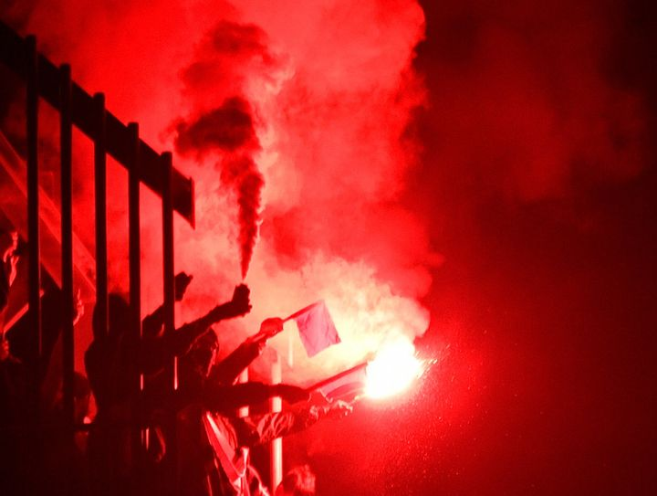People light flares at an anti-far-right concertin Chemnitz in eastern Germany in September. As anti-immigrant populism