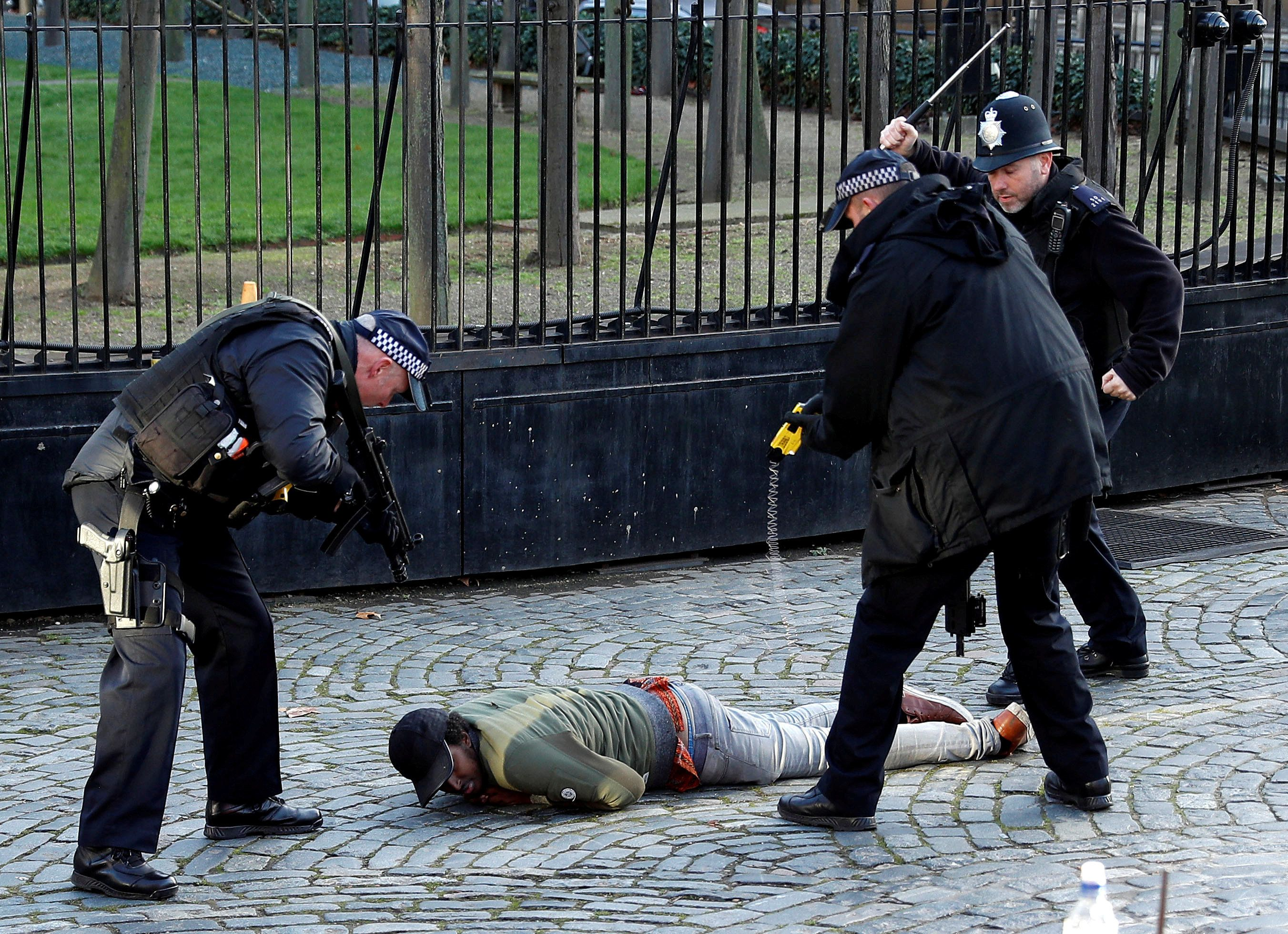 Armed police detain man outside British parliament
