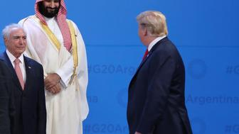 Saudi Arabia's Crown Prince Mohammed bin Salman, center top, watches President Donald Trump, right, passing by as Brazil's President Michel Temer, left, looks on while leaders gather for the for the family photo of the G20 summit in Buenos Aires, Argentina, Friday, Nov. 30, 2018. (AP Photo/Ricardo Mazalan)