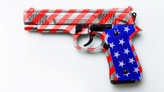 american gun law. Pistol with USA flag colors