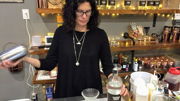 Linda Basina, a co-owner of Copper Crow Distillery, mixes one of the Wisconsin distillery's signature cocktails. Copper Crow