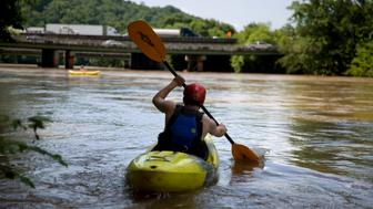Michael Sorenson launches his kayak down the Chattahoochee river as traffic spans Interstate 285 in Atlanta, Wednesday, June 27, 2018. The Supreme Court is giving Florida another chance to make its case that Georgia uses too much water and leaves too little for its southern neighbor. The justices' 5-4 ruling Wednesday concerns a dispute over Georgia's use of water from the Chattahoochee and Flint rivers that serve booming metro Atlanta, Georgia's powerful agricultural industry and Florida's oyster fisheries beyond the river's mouth. (AP Photo/David Goldman)