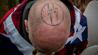 SHELBYVILLE,TN-OCT27: A Nazi tattoo on a White Lives Matter's head in Shelbyville, Tennessee. (Photo by Evelyn Hockstein/For The Washington Post via Getty Images)