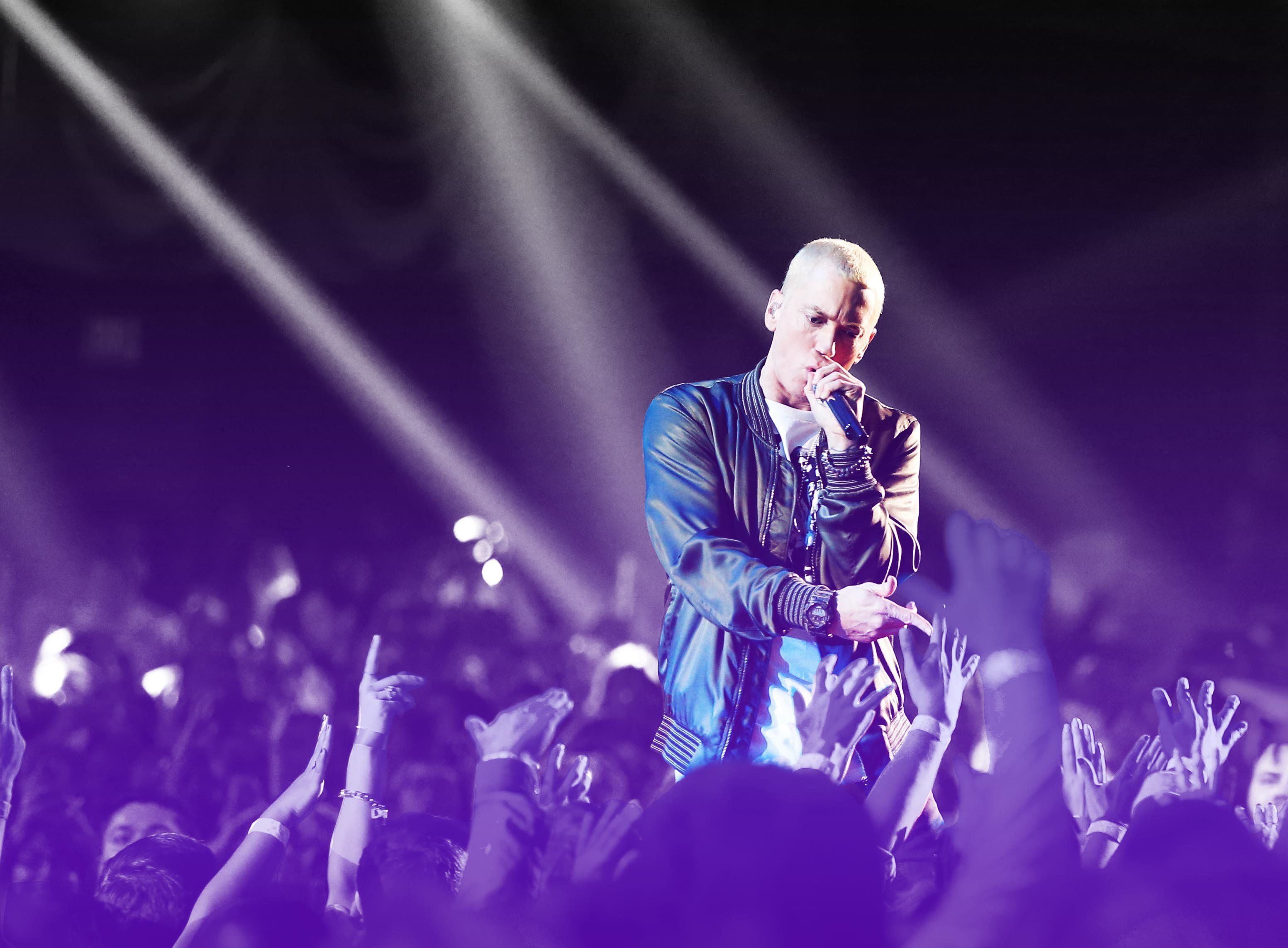 LOS ANGELES, CA - APRIL 13:  Recording artist Eminem performs onstage at the 2014 MTV Movie Awards at Nokia Theatre L.A. Live on April 13, 2014 in Los Angeles, California.  (Photo by Christopher Polk/Getty Images for MTV)