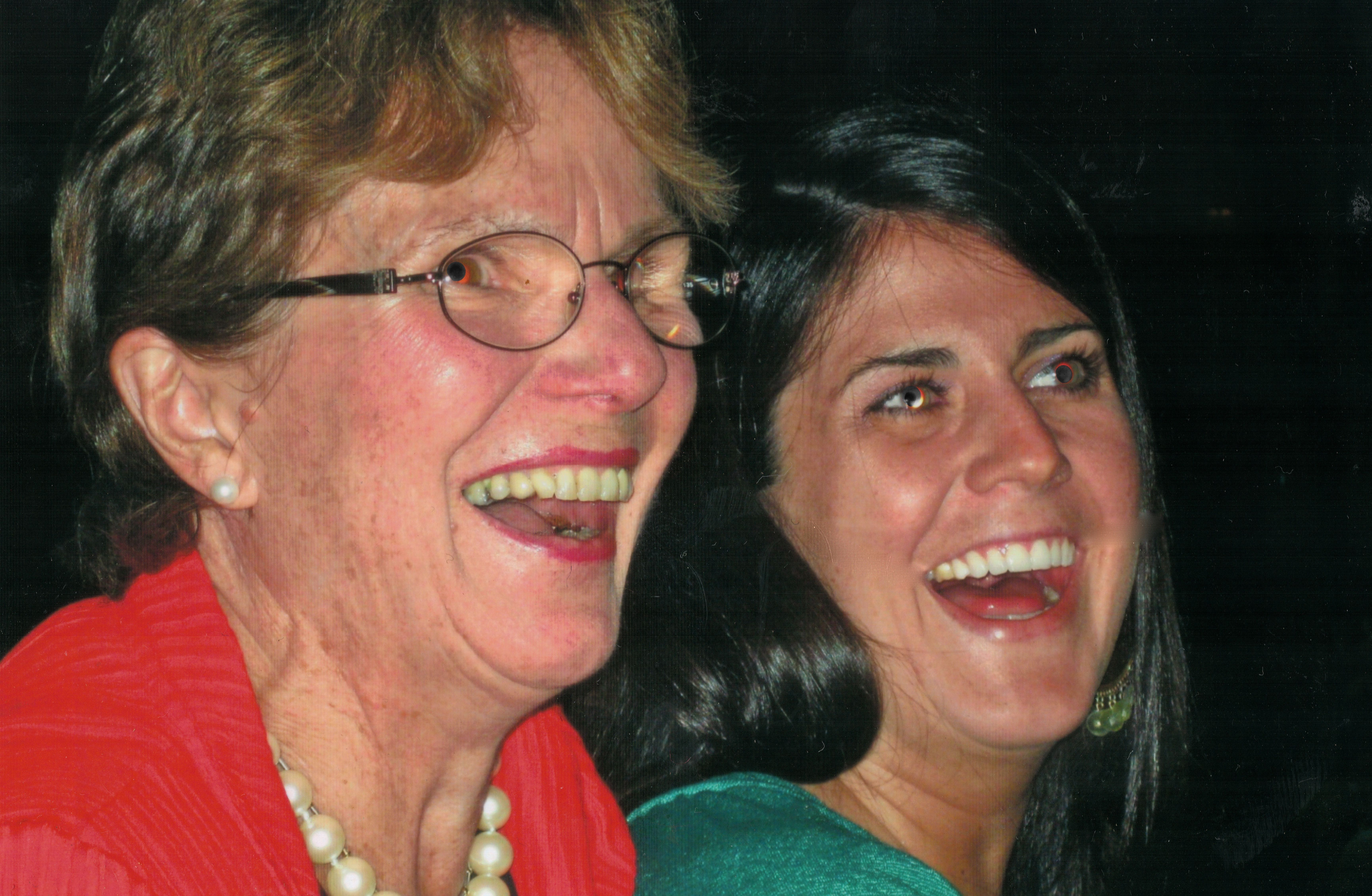 Katie C. Reilly and her mom sharing a laugh at her birthday dinner in the summer of 2008.