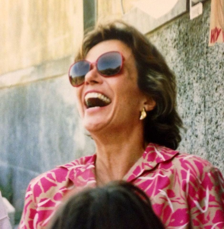 Reilly's mom doing her famous head-thrown-back laugh on a family vacation in the late 1980s.