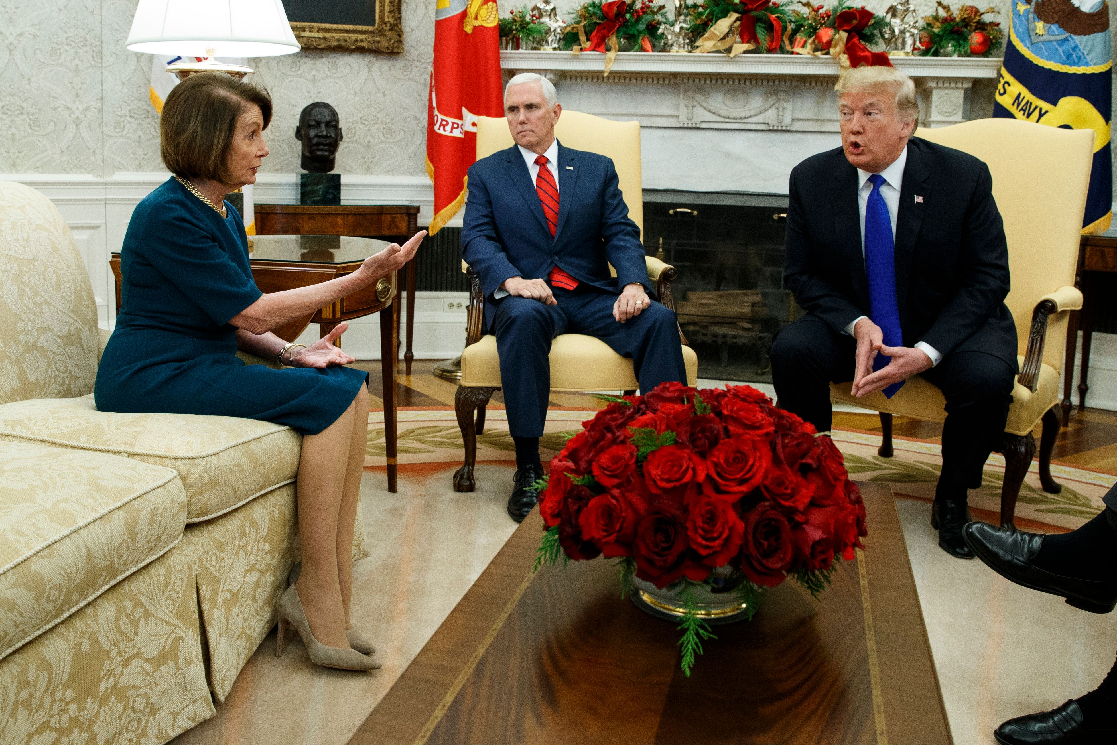 Vice President Mike Pence, center, looks on as House Minority Leader Rep. Nancy Pelosi, D-Calif., and President Donald Trump argue during a meeting in the Oval Office of the White House, Tuesday, Dec. 11, 2018, in Washington. (AP Photo/Evan Vucci)