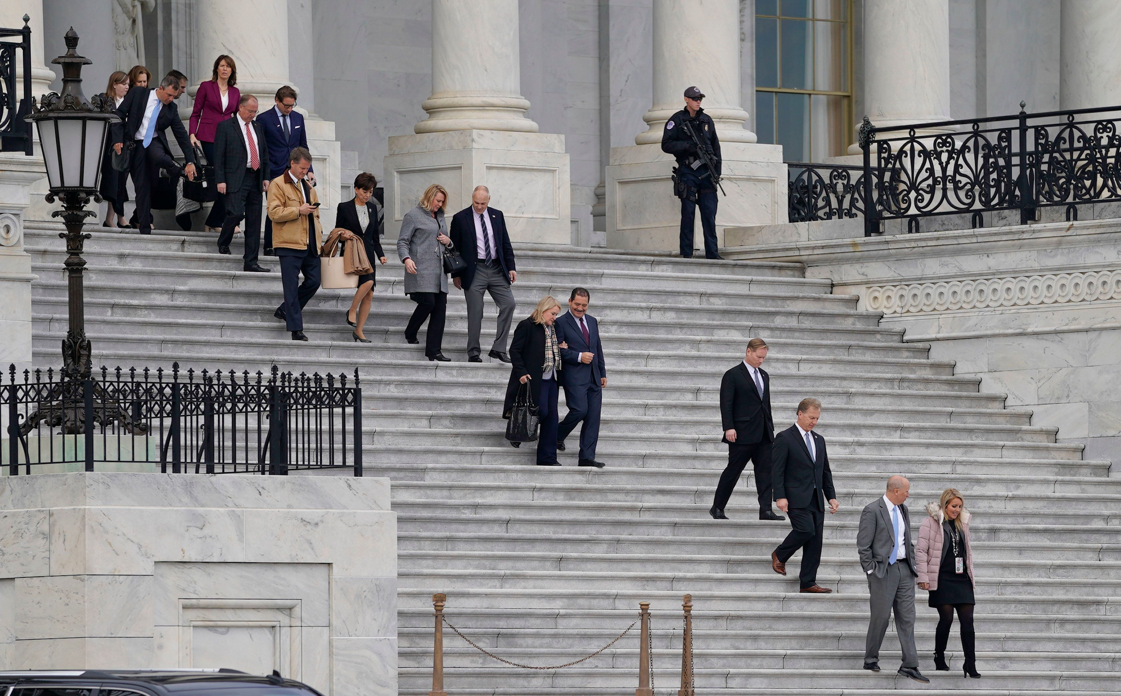Members of the freshman class of Congress walk out of the Capitol before posing for group photo on Capitol Hill in Washington, Wednesday, Nov. 14, 2018. (AP Photo/Pablo Martinez Monsivais)