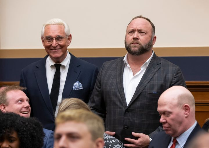 Roger Stone, a confidant of President Trump, left, and radio show host and conspiracy theorist Alex Jones, right, enter the H