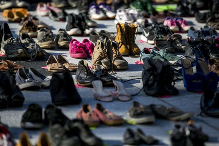 Empty pairs of shoes representing those killed because of Hurricane Maria, outside the Capitol in San Juan, Puerto Rico, June