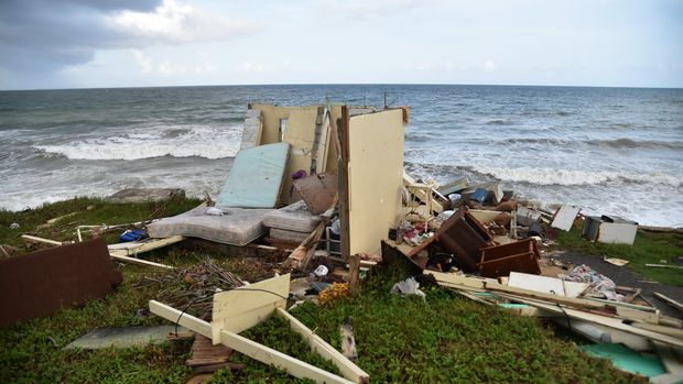 A picture taken on September 28, 2017 shows a house destroyed by Hurricane Maria in  Yabucoa, in the eastern part of storm-battered Puerto Rico. A week after the Category Four storm stuck, the White House said US President Donald Trump had made it easier for fuel and water supplies to arrive to the ravaged island of 3.4 million US citizens. / AFP PHOTO / HECTOR RETAMAL        (Photo credit should read HECTOR RETAMAL/AFP/Getty Images)