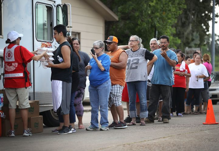 People line up for food and water from the Salvation Army after flooding from Hurricane Harvey in Houston, Sept. 2, 2017. The