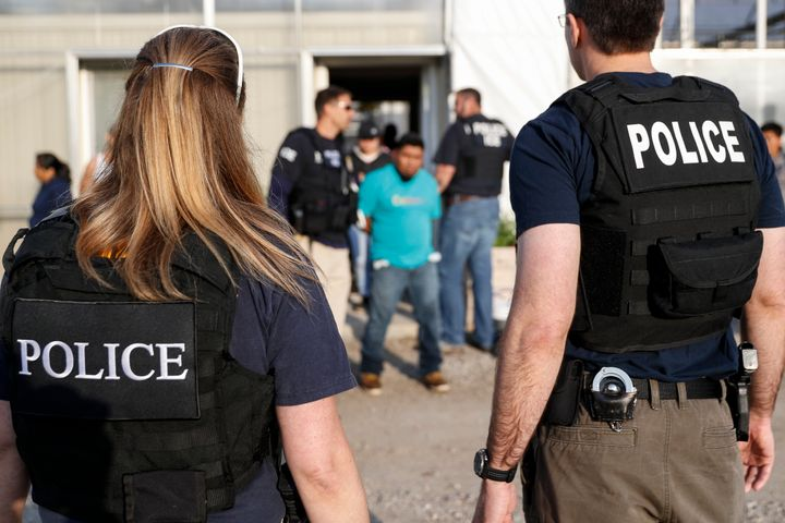 Government agents detain people during an immigration raid in Castalia, Ohio, on June 5. Regular raids are a key part of the