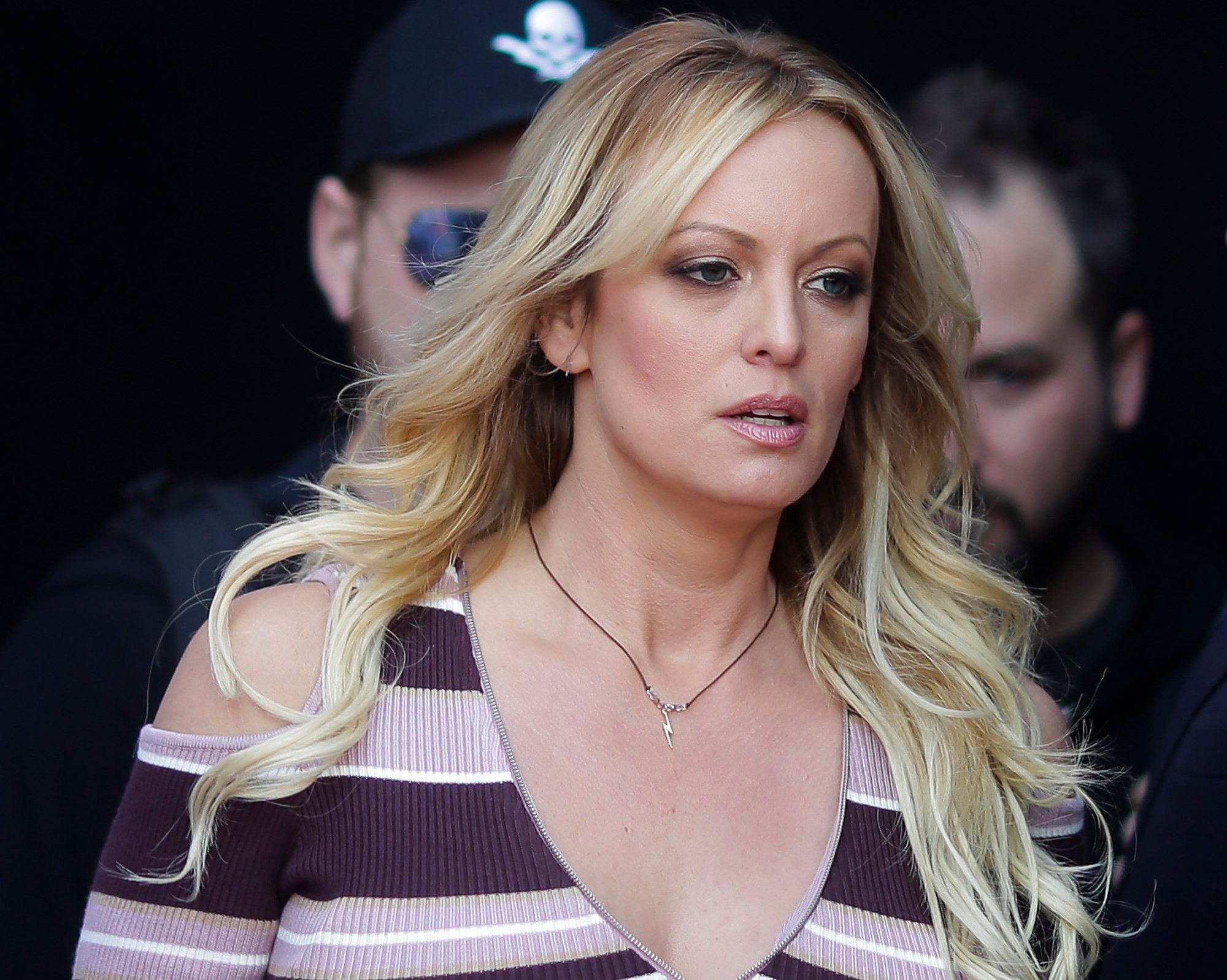 """FILE - In this Thursday, Oct. 11, 2018, file photo, adult film actress Stormy Daniels arrives for the opening of the adult entertainment fair """"Venus,"""" in Berlin. On Monday, Oct. 15, 2018, a federal judge dismissed Daniels' defamation lawsuit against President Donald Trump. (AP Photo/Markus Schreiber, File)"""