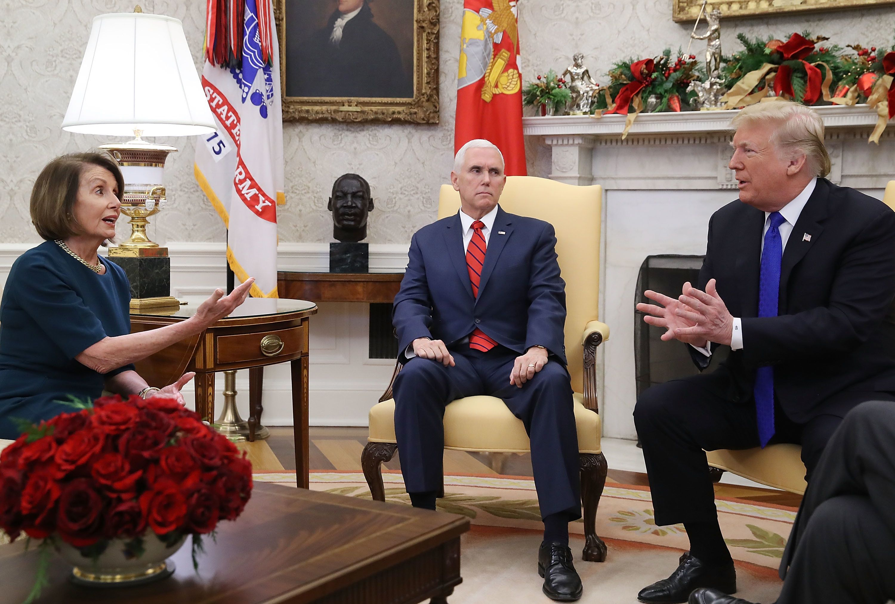 WASHINGTON, DC - DECEMBER 11:  U.S. President Donald Trump (R) argues about border security with House Minority Leader Nancy Pelosi (D-CA) as Vice President Mike Pence (C) sits nearby in the Oval Office on December 11, 2018 in Washington, DC.  (Photo by Mark Wilson/Getty Images)