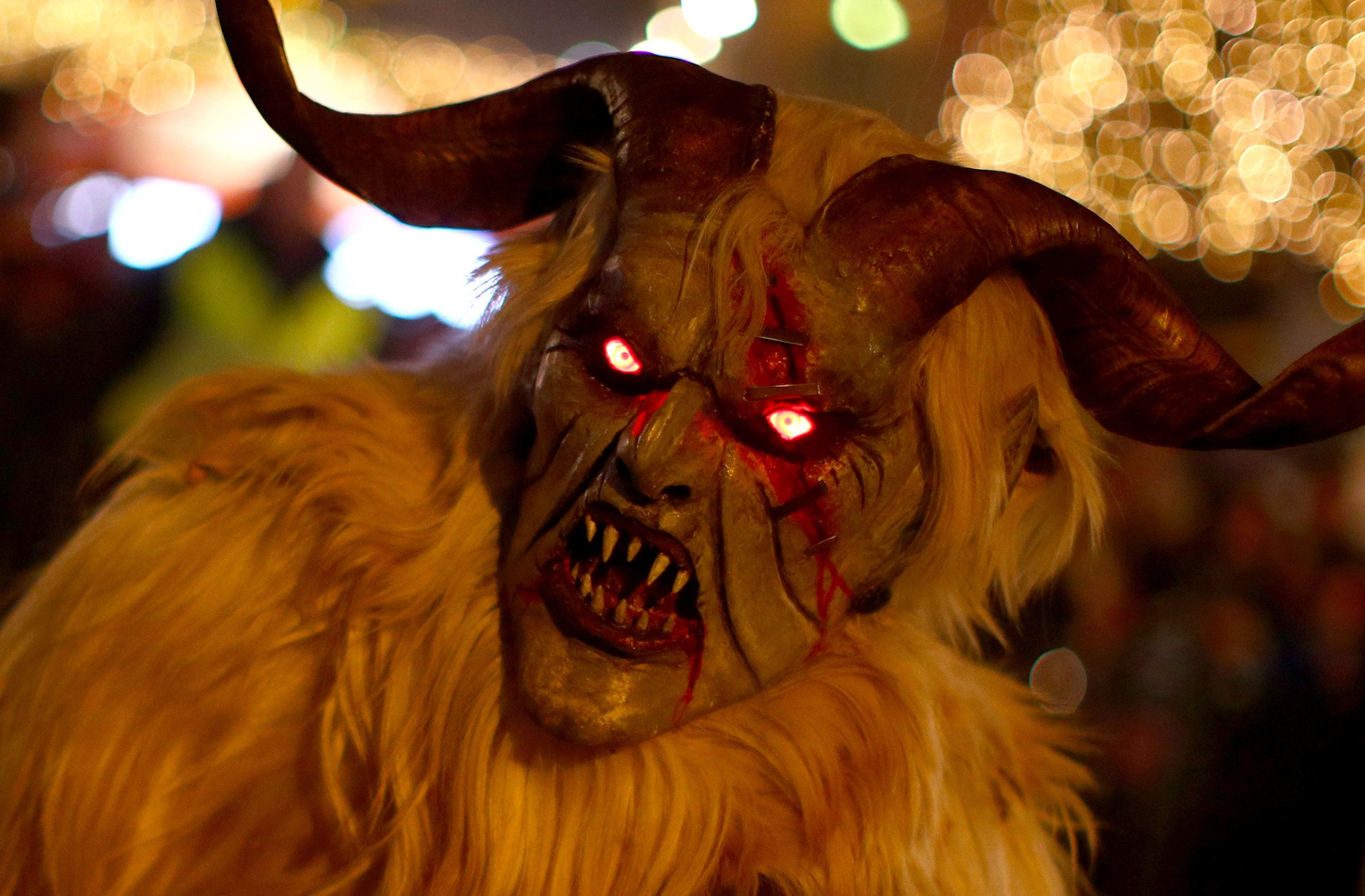 A person costumed as Krampus or Percht, figures from ancient Austrian custom, performs during a Perchten run in Vienna, Austria, December 2, 2018.  REUTERS/Lisi Niesner