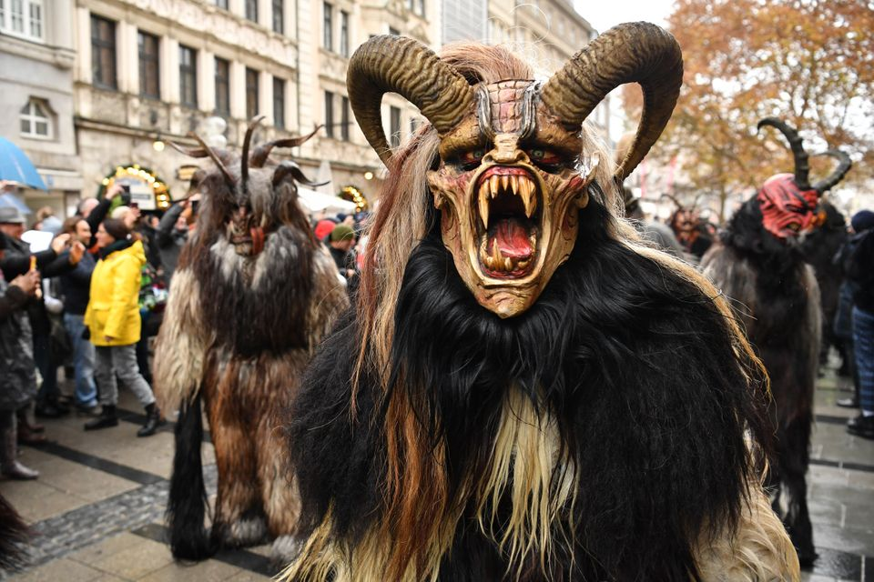 MUNICH, GERMANY - DECEMBER 09: Actors dressed as the Krampus creature parade through the city center's pedestrian shopping di