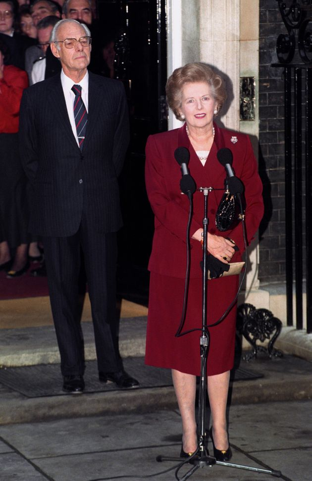 Margaret Thatcher, watched by husband Denis, makes her final speech outside 10 Downing