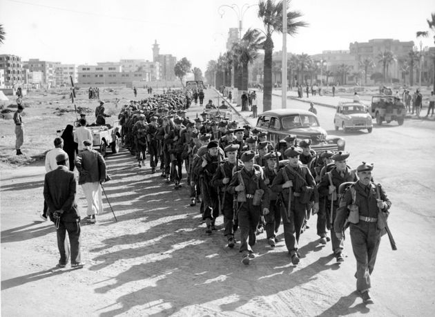 Soldiers of the 1st Battalion the Royal Scots march into Port Said, Egypt, on 16 November, 1956, after...