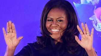 Michelle Obama attends an event at Elizabeth Garrett Anderson School in London, Britain, December 3, 2018. REUTERS/Toby Melville