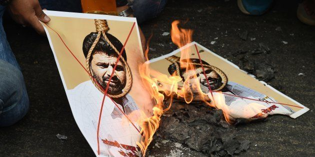 Activists of Indian right-wing Hindu organization Hindu Sena burn photographs of Yakub