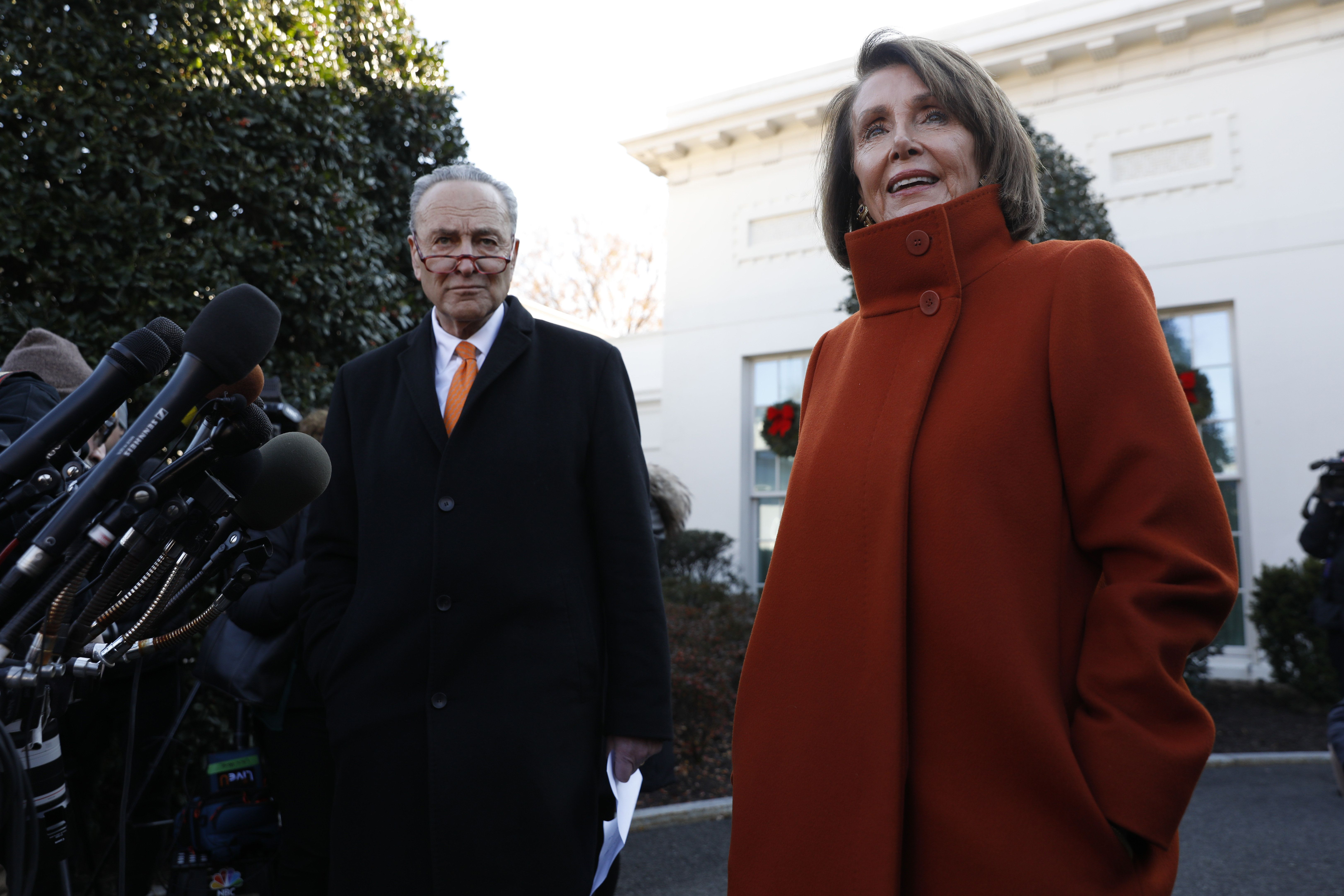 House Minority Leader Nancy Pelosi, a Democrat from California, speaks with members of the media with Senate Minority Leader Chuck Schumer, a Democrat from New York, left, at the White House in Washington, D.C., U.S., on Tuesday, Dec. 11, 2018. If President?Trump?sticks to his demand for $5 billion in funding for a wall on the U.S. border with Mexico, he will get no wall and a shutdown, Schumer told reporters after the meeting. Photographer: Yuri Gripas/Bloomberg via Getty Images