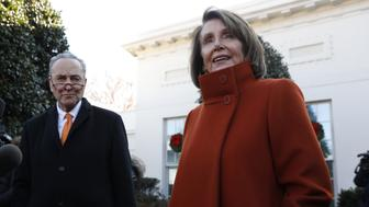 House Minority Leader Nancy Pelosi, a Democrat from California, speaks with members of the media with Senate Minority Leader Chuck Schumer, a Democrat from New York, left, at the White House in Washington, D.C., U.S., on Tuesday, Dec. 11, 2018. If PresidentTrumpsticks to his demand for $5 billion in funding for a wall on the U.S. border with Mexico, he will get no wall and a shutdown, Schumer told reporters after the meeting. Photographer: Yuri Gripas/Bloomberg via Getty Images