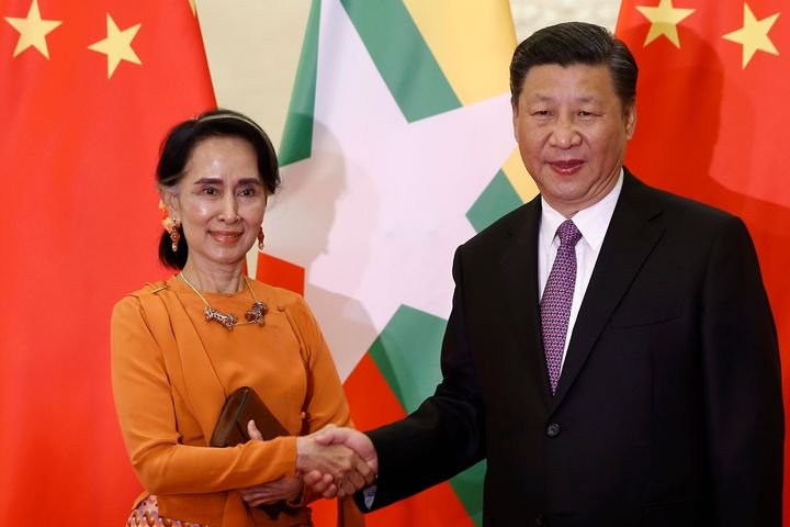 Myanmar State Counsellor Aung San Suu Kyi (left, with Chinese President Xi Jinping) is often cited as an example that women h