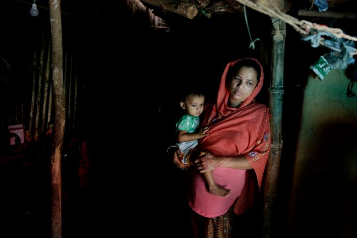 A Rohingya refugee who fled Myanmar.  She has convinced her husband to let their eldest daughter study.