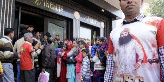 NEW DELHI, INDIA - FEBRUARY 13: Followers rushed to cinema hall to watch controversial film 'MSG The...