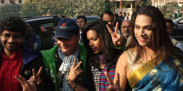 SUPREME COURT, NEW DELHI, INDIA - 2016/02/02: Members of the LGBT community Show Victory Sign outside...