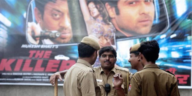 New Delhi, INDIA: Indian policemen stand outside a theatre after a telephone call was received at a police...