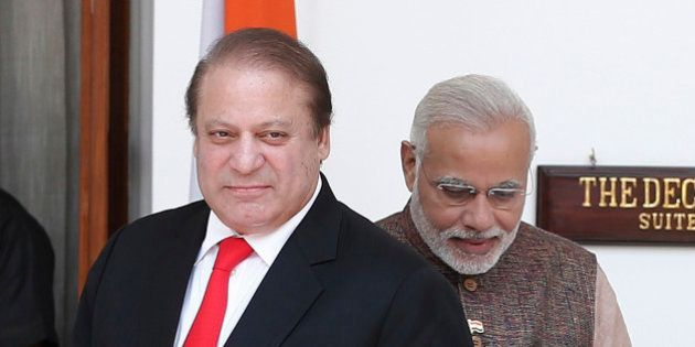 Pakistan's Prime Minister Nawaz Sharif (L) arrives for his bilateral meeting with his Indian counterpart...
