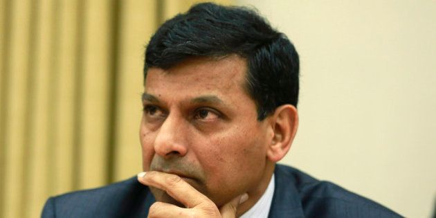 Reserve Bank of India (RBI) Governor Raghuram Rajan listens to a question from a journalist during a...