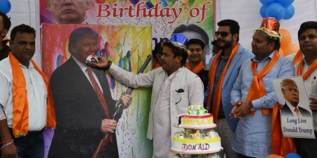 Indian right-wing Hindu activists hold a celebration to mark the 70th birthday of US Republican presidential...