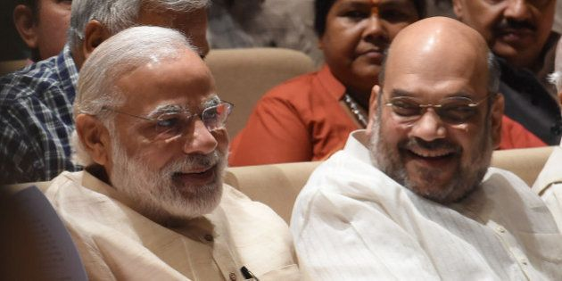 India Bharatiya Janata Party (BJP) President Amit Shah (R) speaks with Prime Minister Narendra Modi during...